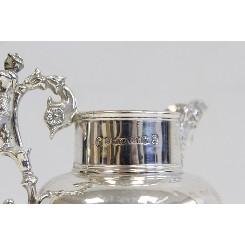 40 - Silver cream pitcher of tapering shape with cast mask spout and handle, Edinburgh 1874. 4oz....