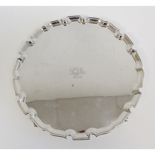 42 - Silver circular waiter with shaped moulded edge 1959, 25.5cm. 18oz....