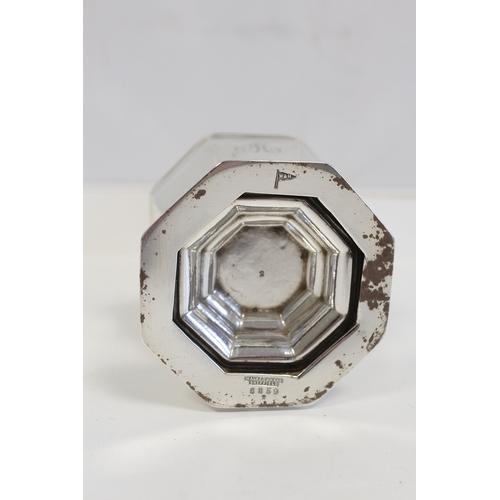 46 - Silver caster of octagonal baluster shape, Sheffield 1927. 4oz....