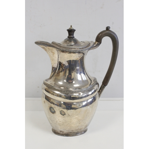5 - Silver hot water pot of oval baluster shape, by Harry Atkin, Sheffield 1902. 20oz....