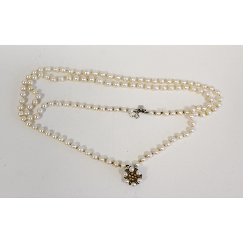 8 - Cultured pearl two strand necklace of almost equal sized beads, on similar snap....
