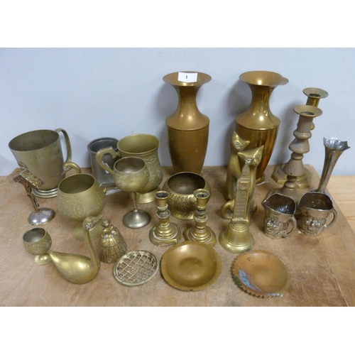 1 - Pair of brass candlesticks, a pair of brass vases and another pieces of decorative brassware