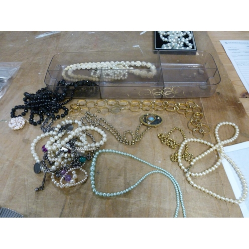 56 - Large collection of costume jewellery to include simulated pearls, beads, brooches etc