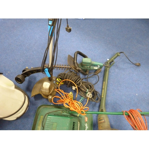 6 - Collection of gardening tools to include strimmer, lawnmower etc