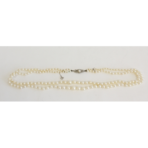 50 - Twin strand cultured pearl necklace, graduated form 3.5-8.5mm with a white metal clasp...