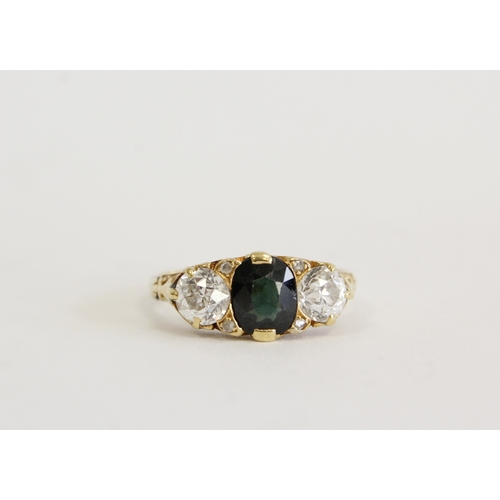 52 - Yellow metal ring set with tourmaline flanked by two diamonds Size O...