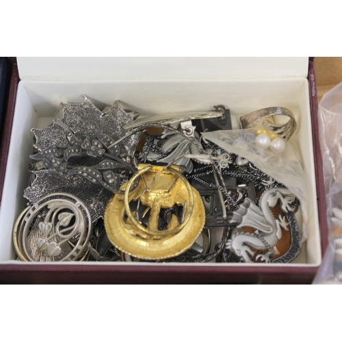 59 - Collection of costume jewellery to include some silver...