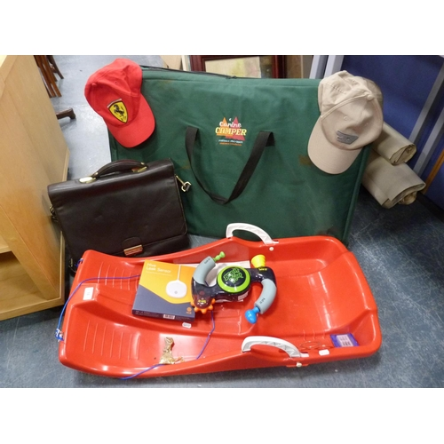 18 - Hive leak sensor, child's sledge, caps, Bop-it Extreme 2 game, satchel and a Canine Camper portable ...
