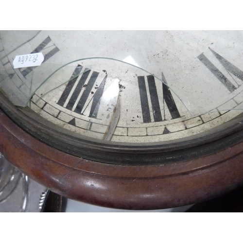 26 - Mahogany wall clock of circular form with white enamel face and Roman numerals.