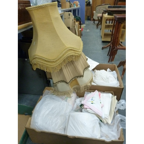 37 - Two cartons of vintage linen and tablecloths, also a quantity of lampshades.