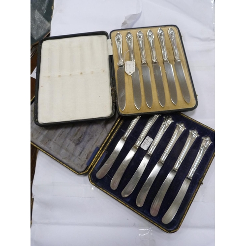 46 - Two sets of six silver-handled knives (Sheffield and Birmingham).