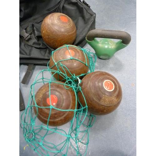 60 - Pannier bag and four bowling balls.