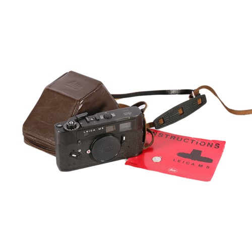Ernst Leitz Wetzlar Leica M5 camera body, serial number 1287744, in a Leica trapezoidalprism shaped brown leather case