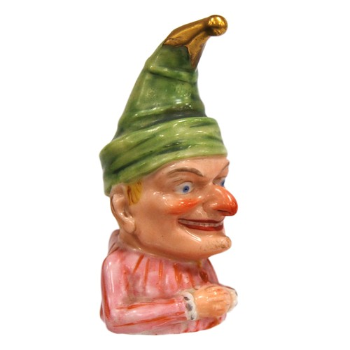 Victorian Royal Worcester novelty candle snuffer modelled as Mr Punch, designed by James Hadley, wearing a green hat with gilded tip, pink striped shirt, hands draped, marks to underside, 9cm high.