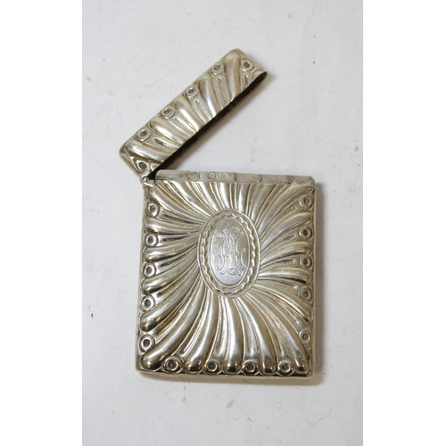 31 - Silver card case with radiating embossing by W. Comyns 1899, 138g.