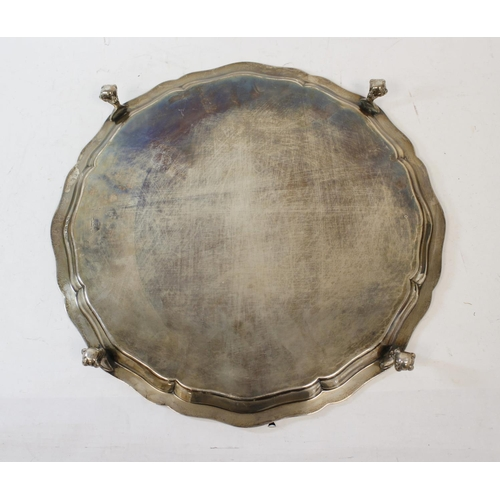 51 - Silver circular tray with shaped moulded Celtic border by Reid & Sons, Newcastle 1919, 41oz / 13...