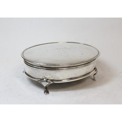 6 - Silver oval bijouterie box, initialled, on spreading feet, Sheffield 1928, 16cm.