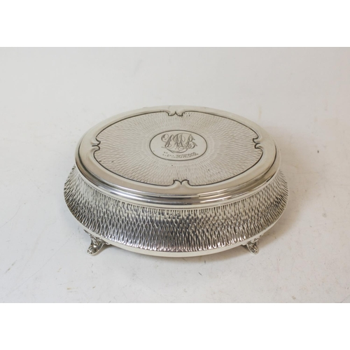 7 - Silver oval bijouterie box, hammered, monogramed and dated 1909, by Zimmermans, Birmingham 1908.