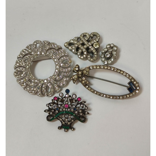 11 - Antique paste brooch, another Art Deco, seven similar items, two 'bambi' brooches, a rattle (a.f), t...