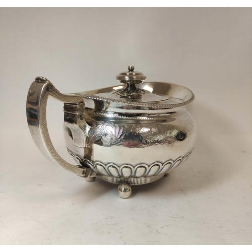 21 - Silver tea pot of compressed spherical shape engraved and semi-gadrooned, by Robertson & Walton,...