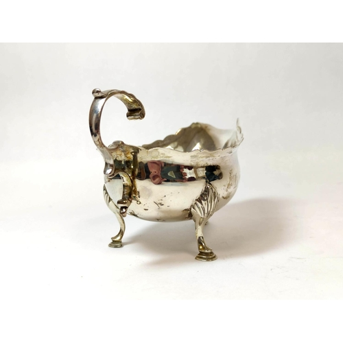 25 - Silver cream boat with cut edge and scroll handle, makers mark not clear, 1794, 3 1/2oz / 114g.