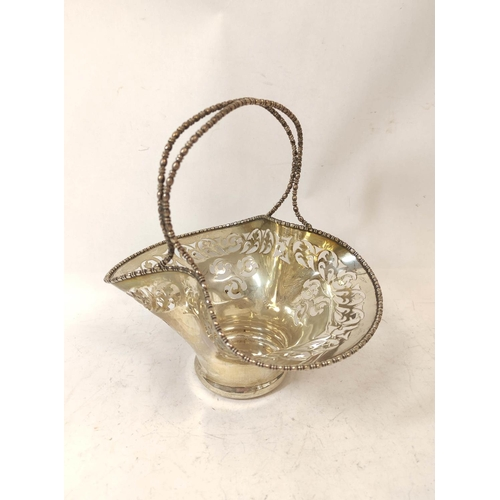 26 - Silver cake basket of pinched shape with beaded handle by Fenton brothers, Sheffield 1911, 9oz / 285...