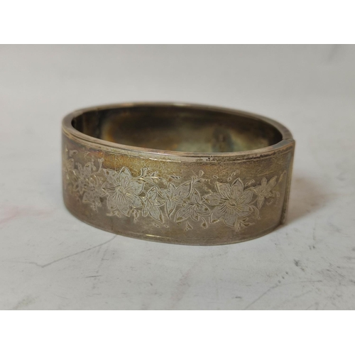 27 - Silver box of scallop shape, Import Marks 1900, another unmarked and a half engraved bangle, Birming...