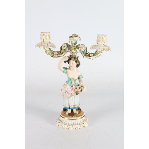 15 - Continental porcelain candlestick in the form of figure, 28cm