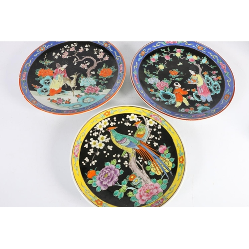 22 - Three Japanese plates, two decorated with figures, the other decorated with birds