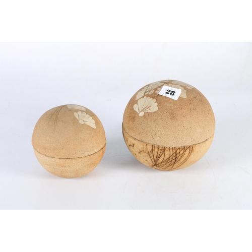 28 - Two stoneware spherical jars, stamped OCG to base