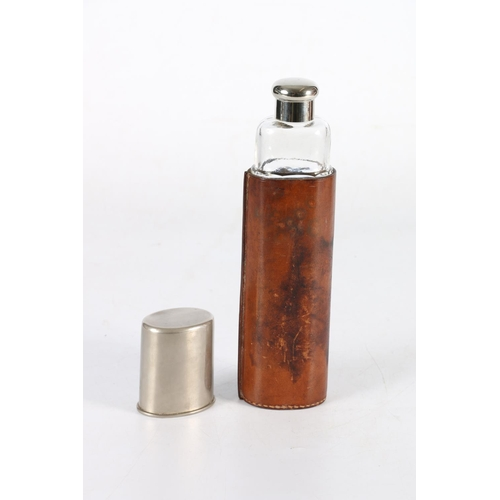 3 - Glass hunting flask with leather sleeve, 24cm