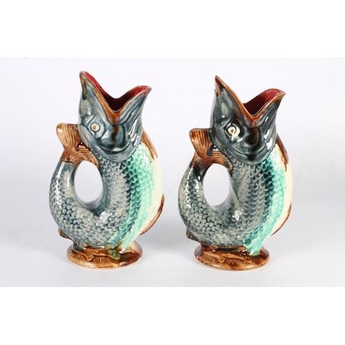 32 - Pair of fish gurgle jugs, 24cm