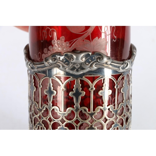 4 - Ruby glass flash-cut wine decanter with pierced white metal sleeve and white metal top, 35cm