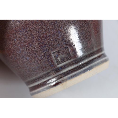 46 - Small fat lava style vase, an aubergine glazed vase, indistinctly marked and a small marbled effect ...