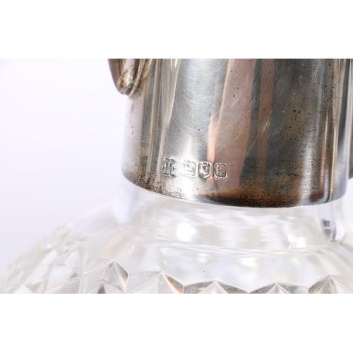 18 - Antique silver mounted cut glass ewer, the mounts byHukin & Heath (John Thomas Heath & John...