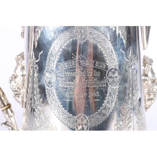 2 - Victorian silver lidded ewer with applied lion masks, shell thumb piece and allover engraved decorat...