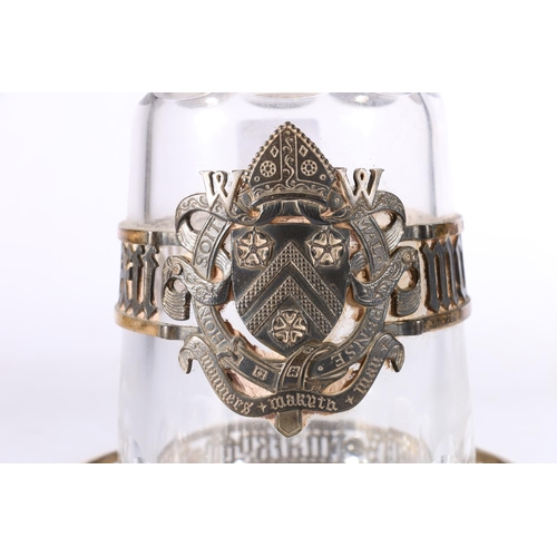 23 - Winchester College interest, a contemporary silver gilt clad cut glass decanter on wide slide stand ...
