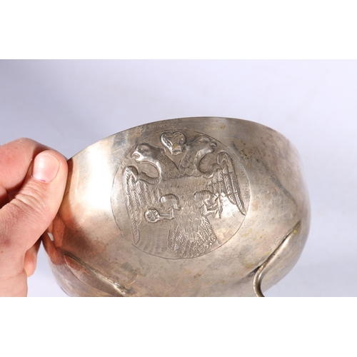 35 - An 830 grade silver bowl with embossed double eagle and other designs, possibly Cypriot, 309g, 17cm ...