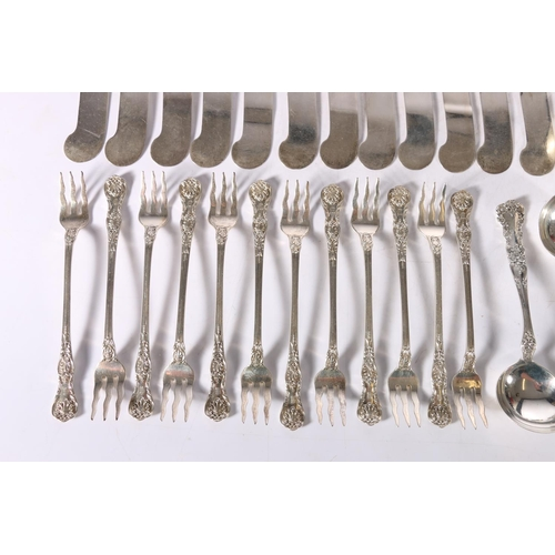 40 - Harlequin suite of Continental Sterling silver flatware including the butter knives, serving spoons,...