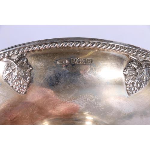 52 - Contemporary silver pedestal dish with relief grape border byAlbert Edward Jones, Birmingham 1976, ...