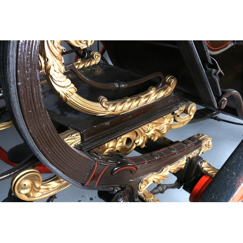 4 - STATE LANDAU, c.1830. In dark brown with red lining and red lined wheels, heavily gilded foliate mo...