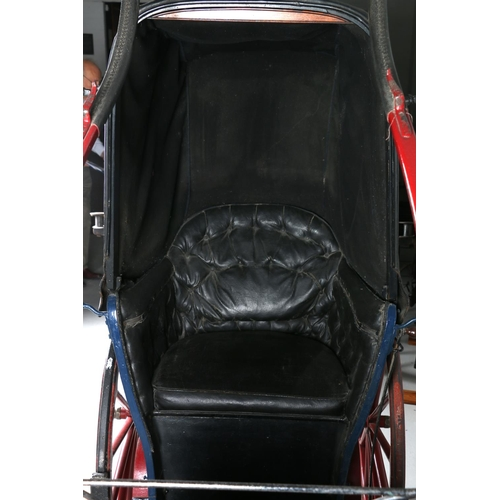 6 - PONY PHAETON, or invalid carriage. In blue on maroon/red running gear, lined black. Leather head and...