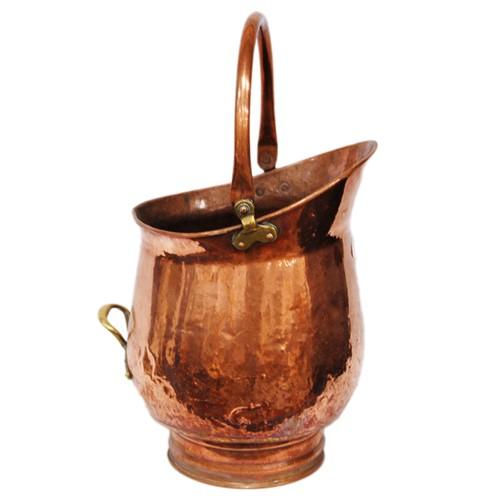 Copper coal bucket.
