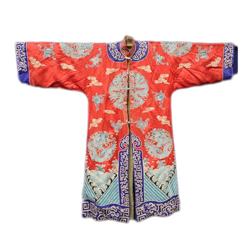 19th century Chinese embroidered red silk court dragon robe with mandarin collar and three knot fastenings to front, roundels of scrolling five clawed dragons over waves with further Buddhist symbols, worked in mainly blue and gilt threads with blue silk borders to neck, cuffs and hem, with hessian lining, some repairs/damages.