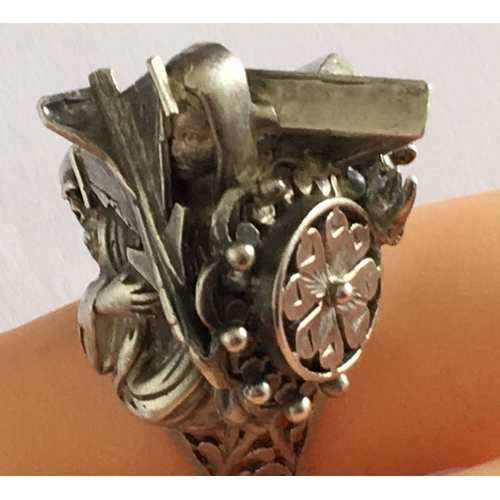 26 - <p>Vintage Modernist Silver Ring depicting Religion,War, Death marked NSS.</p> <p>The cost of UK Pos...