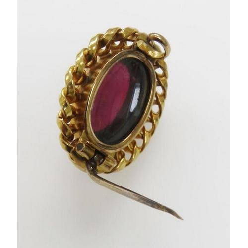 47 - <p>Victorian yellow metal and garnet brooch (tests as 18ct). Secret glazed keepsake compartmen...
