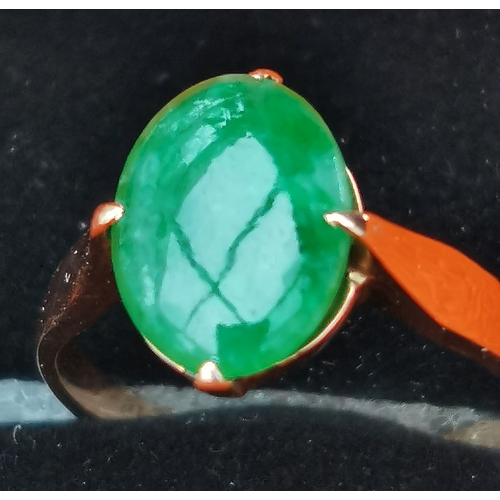 46 - <p>Vintage Wang Hing 18ct Gold and Jade Ring UK size (N 1/2) - stone 12mm x 7mm.</p> <p>In our opini...