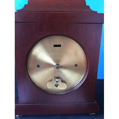 11 - Garrard small bracket mantle clock. Ornate hands, cherub spindles with mahogany effect case. Finish ...