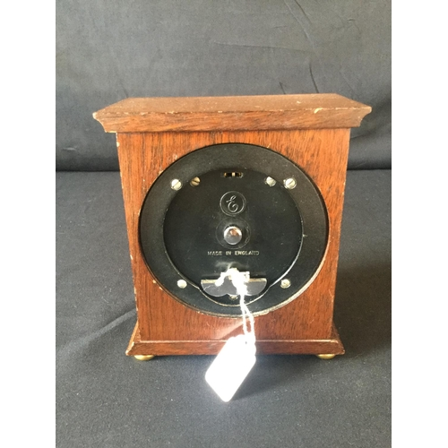 12 - Garrard small mantle clock. Platform escapement, slight scratches to case. Bezel in poor condition....