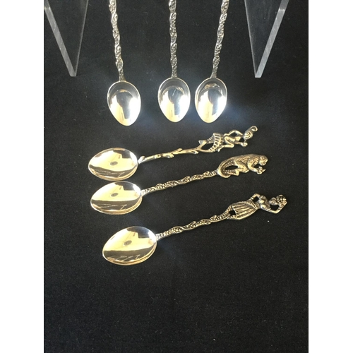 21 - Set of 6 Silver foreign spoons with animal / palm tree theme weight 30.9 grams...